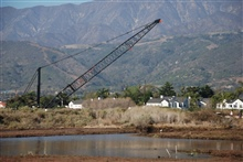 Carpinteria, Carlifornia - After the Montecito flood, the Salt Marsh creeks filled with debris and required dredging. Many of the running/walking paths were damaged